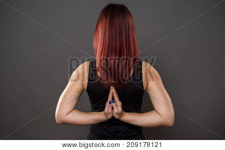 Closeup of beautiful young woman in a yoga pose