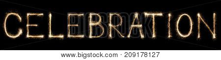 Celebration text made from burning sparkles on black background. Shiny festive party firework font.