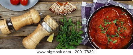 Dining Table. Meatballs With Parsley And Cherry Tomatoes And Various Snacks.