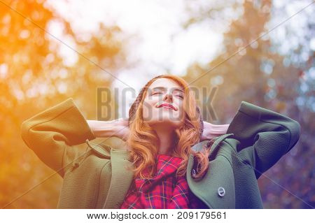 Young Redhead Woman In Red Dress With Green Coat At Autumn Outdoor