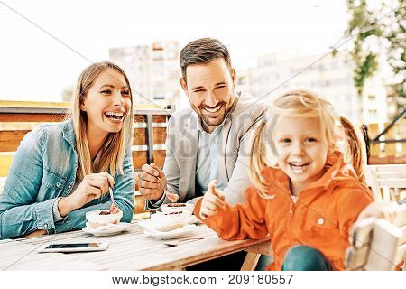 Family Enjoying Restaurant