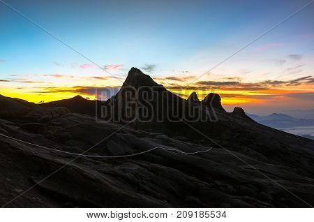 View from the top of Low's Peak of Mountain Kinabalu,Sabah during morning sunrise.Its the highest mountain in Malaysia is one of Borneo's most popular tourist attractions & climbers.
