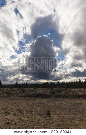Dramatic Clouds Over Desert Landscape