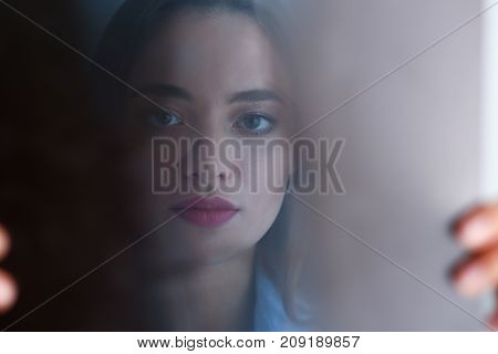 Beautiful female doctor hold in arm and look at xray photography portrait. Skeleton bone disease exam medic aid or cancer physical test in hospital for healthy lifestyle education career concept