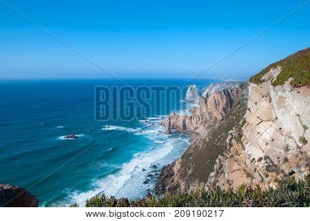 Ocean meets Cliffs of Cabo da Roca Cape Roca in Sintra - the westernmost extent of mainland Portugal and Europe