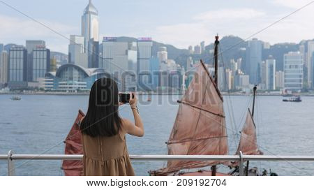 Woman taking photo in Victoria harbor