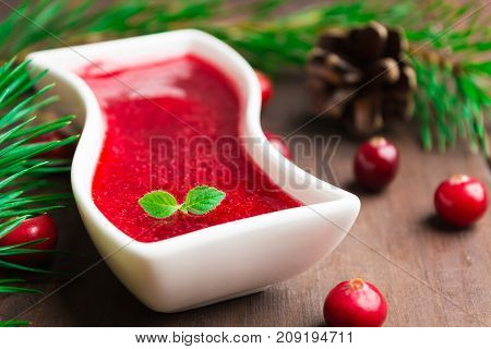 Closeup View Of Red Cranberry Sauce In White Sauce Pan