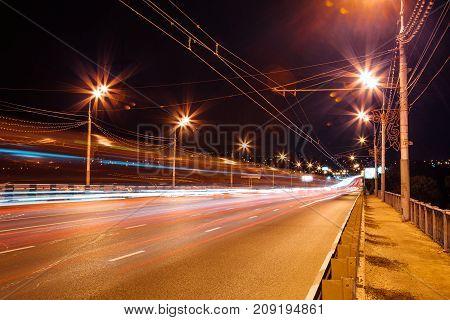 Traffic light trails on the bridge. Night Voronezh