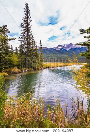 The wind creates a ripple on the lake water. Magnificent journey through the Rocky Mountains of Canada. Concept of active and ecological tourism