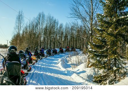 Finland. Winter fairy tale in a sunny frosty day. The first trip on snowmobiles. The concept of active and extreme tourism