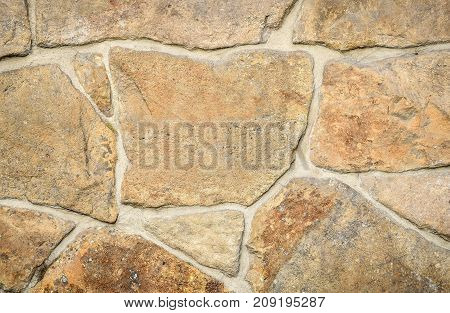Creative stone background. Texture of stone on the wall.