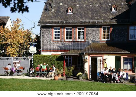 TAUNUSSTEIN-WEHEN, GERMANY - OCTOBER 15: Visitors of the Wehen Castle sit outside in a cafe on October 15 2017 in Taunusstein-Wehen.
