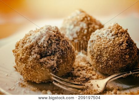 Close up Plum fruit dumplings with brown sugar