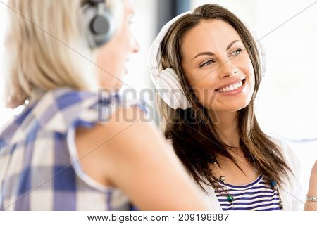 Young woman with headphones indoors