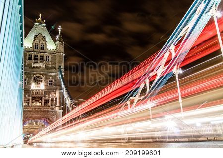 Traffic Whizzing Across Tower Bridge In London The Uk.