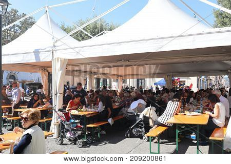 People Eating And Drinking At Local Festival
