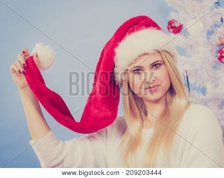 Happy Young Woman Wearing Santa Claus Hat