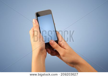 Female fingers touching blank smartphone