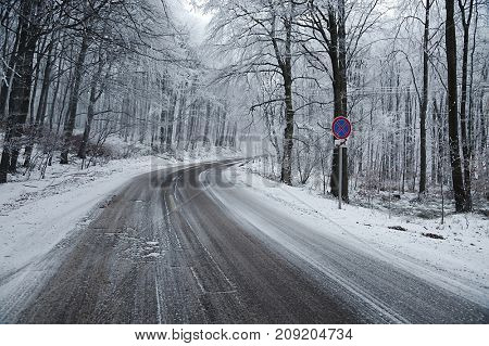 Mountain road with snow all over