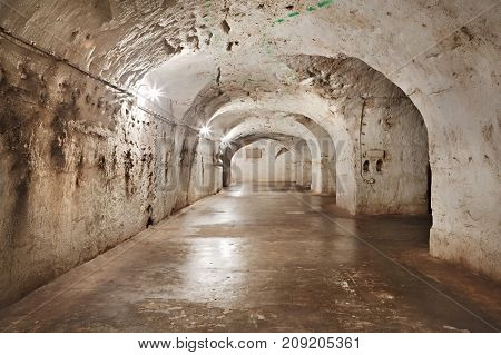 Underground tunnel with lights and flat floor