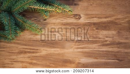 christmas wooden background with fir branches and balls