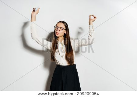 a happy girl in glasses with long hair lifted up gold coins. Bitcoins, crypto currency