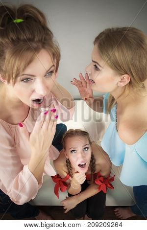 Woman Being Gossiped By Two
