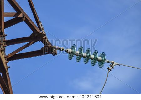 Glass prefabricated high voltage insulators on poles high-voltage power lines. Electrical industry. poster