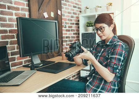Female Photographer Holding Business Camera