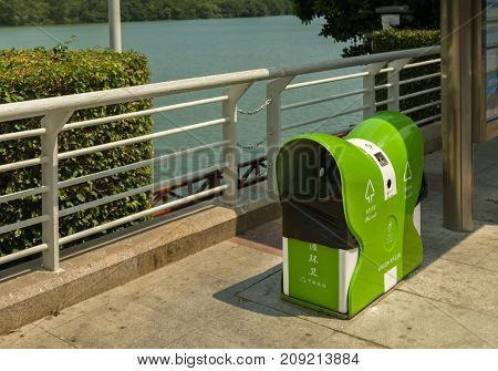 Sanya, China - April 02, 2017: Garbage container in the street of the tourist city of Sanya