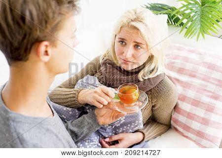A portrait of a sick couple having flu