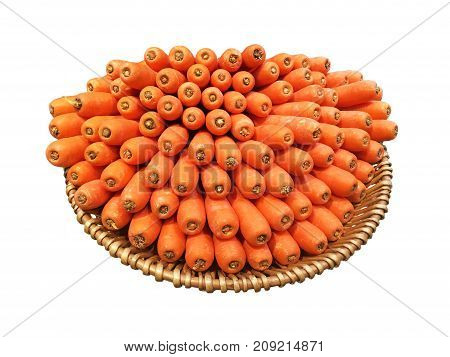 Heap of orange carrots display in bamboo basket isolated on white background.