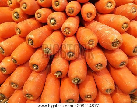 Heap of orange carrots to display in supermarket.