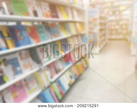 Abstract blur background of book on shelves at bookstore.