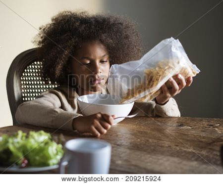 African child ready to eat breakfast