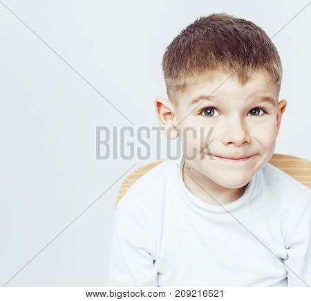 little cute adorable boy posing gesturing cheerful on white background, lifestyle people concept close up