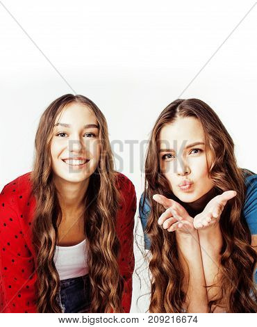 best friends teenage girls together having fun, posing emotional on white background, besties happy smiling, lifestyle people concept close up. making selfie