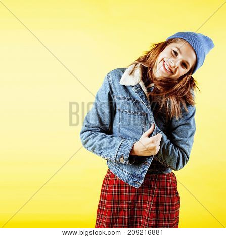 lifestyle people concept: pretty young school teenage girl having fun happy smiling on yellow background close up