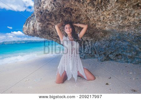 Beautiful woman in dress on beach at Thailand