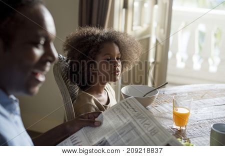 African family in a dining room