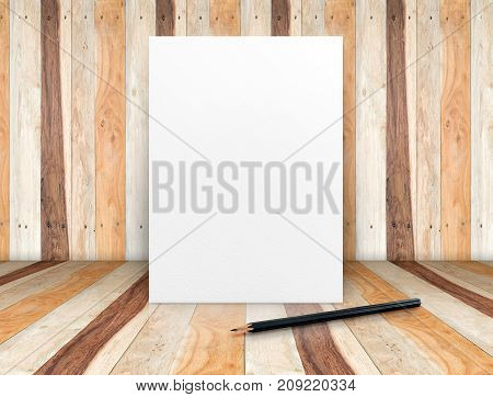 Blank white poster with pencil leaning at wooden wall on plank floorTemplate mock up for adding your designBusiness presentation.