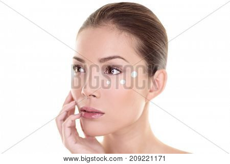 Eye cream face skin care woman putting eyebag wrinkles care anti aging treatment. Skincare Asian beauty touching in studio isolated on white background. Natural makeup spa clear and clean skin.