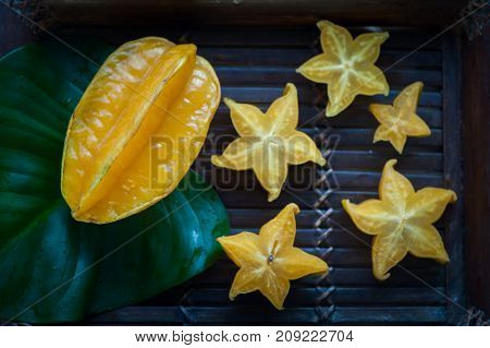carambola in natural conditions on a beautiful tropical background. Exotic fruits