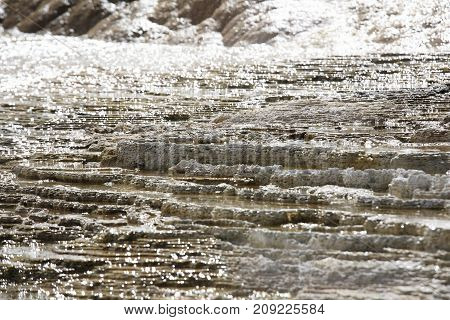 Water flowing over the shale in Mammoth Hot Spring