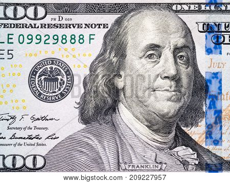 Portrait of Benjamin Franklin from one hundred dollars bill texture