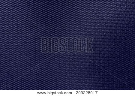 corrugated background and abstract wattled texture of fabric or textile material of dark violet color