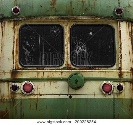 Clsoe upback view of an old rusty green and yellow train car. Two windows are clipped outr with a clipping path.