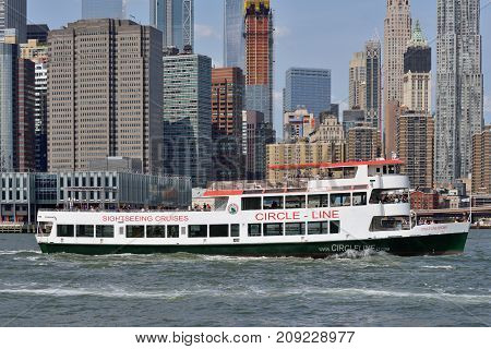 NEW YORK CITY - AUG. 27: boat in the East River on August 27 2017 in New York City NY. The East River is a salt water tidal estuary in New York City.