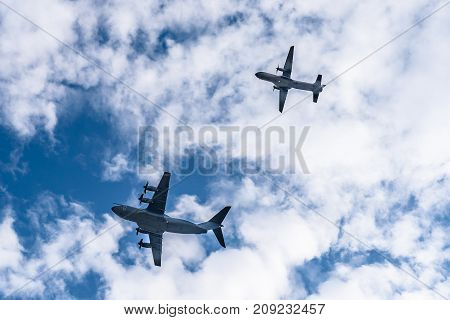 Madrid, Spain - October 12, 2017: Airbus A400M and  Casa C-295 transport aircrafts flying in formation in Spanish National Day Parade against blue and cloudy sky