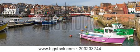 WHITBY, NORTH YORKSHIRE, ENGLAND, UK-FEBRUARY 21ST 2017: Fine calm winter weather was enjoyed by sailors and visitors to the harbour Whitby, North Yorkshire, on Tuesday 21st February 2017
